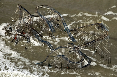 A roller coaster sits in the surf after Hurricane Sandy destroyed the boardwalk and pier in Seaside Park, New Jersey October 31, 2012.