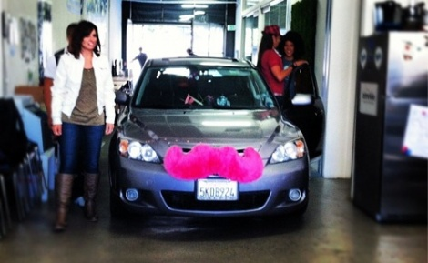 The detachable pink mustache alerts ride-seekers that this ride is a Lyft.