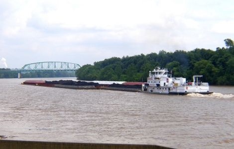 A barge carries environmentally-friendly coal up the Ohio River