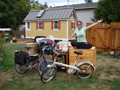 Lina Menard with her possessions, sitting outside a tiny home she lived in for 10 months.
