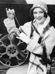 film-reel-woman-black-white-shutterstock