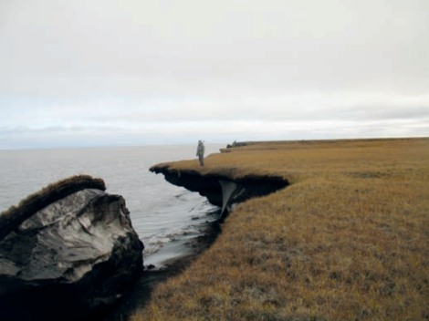 Near Alaska, a chunk of permafrost breaks off into the Arctic Ocean