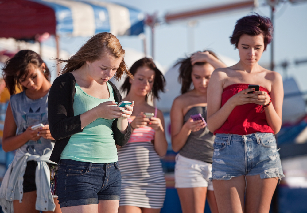 young women with smartphones