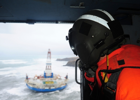 Rear Adm. Thomas Ostebo, commander, 17th Coast Guard District and D17 Incident Management Team commander, observes the conical drilling unit Kulluk from an MH-60 Jayhawk helicopter during a second overflight Tuesday, Jan. 1, 2013.