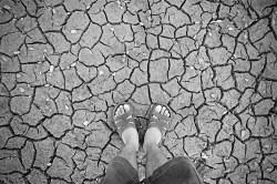 dry-cracked-soil-farmer
