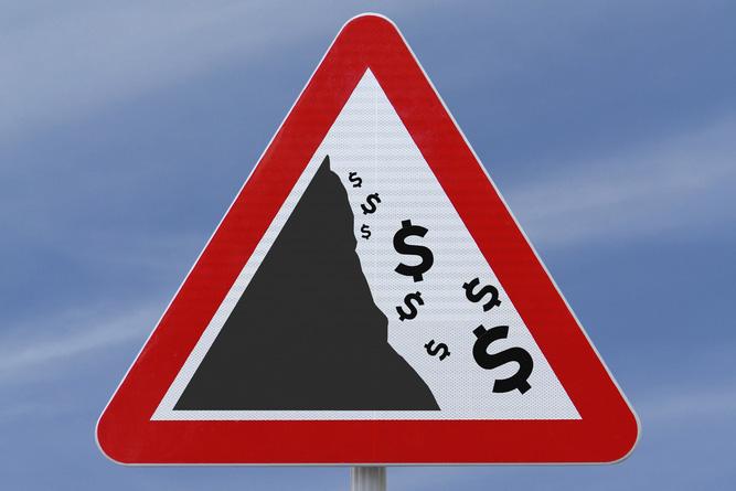dollar signs falling down a cliff