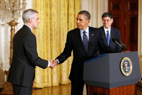 The president shakes McDonough's hand as Lew looks on