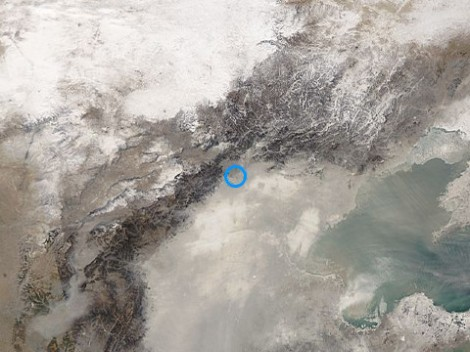Smog covering Beijing (blue circle) on Saturday …
