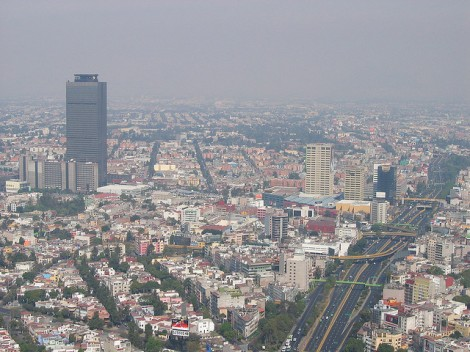 The Pemex headquarters towers over Mexico City on a smoggy day in 2004