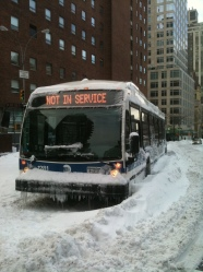 A New York City bus, stuck during a 2010 blizzard