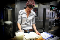 Christina Waller at work in the coop's central kitchen.