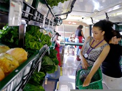 The Fresh Moves buses bring locally grown produce to city neighborhoods.