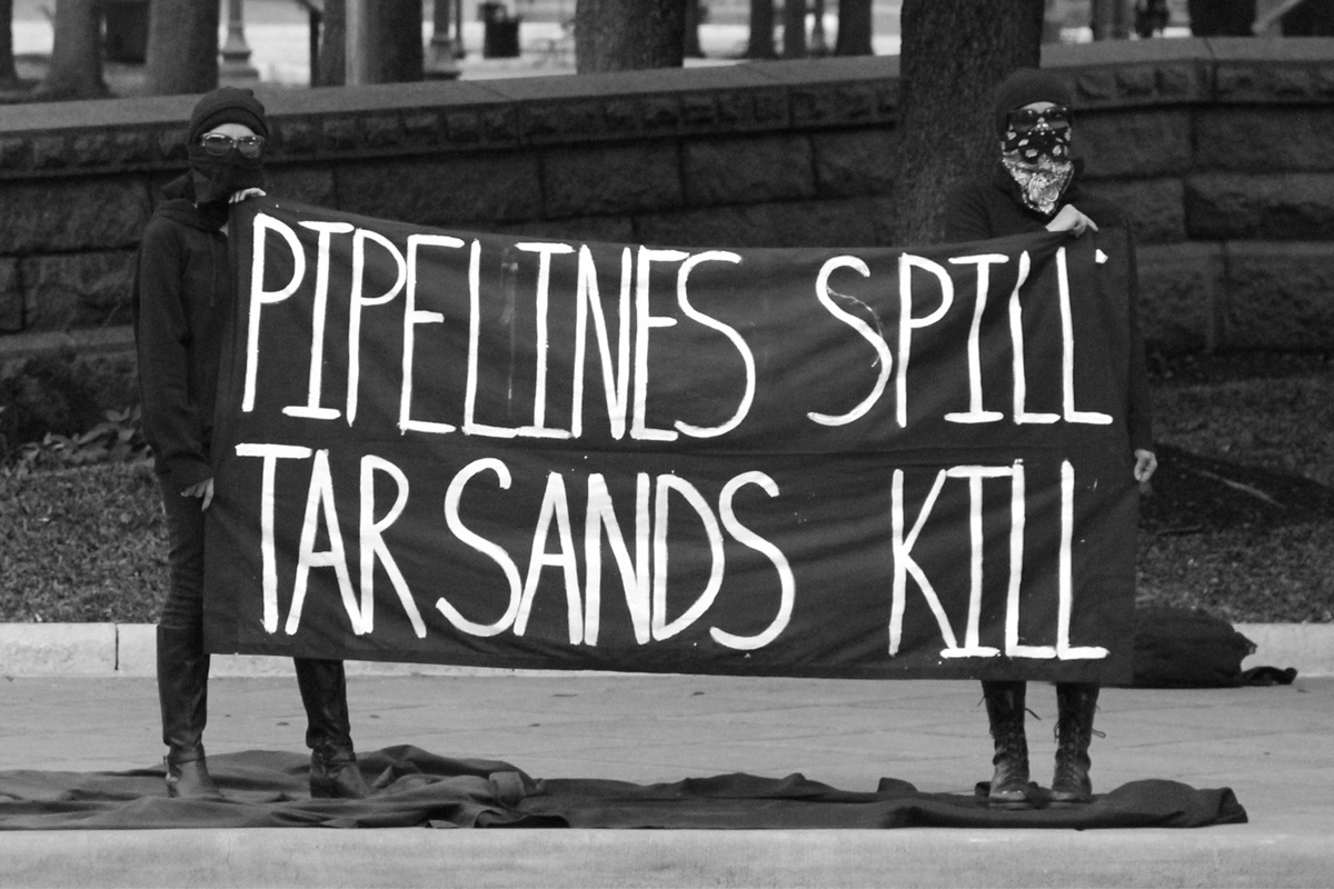 protest sign: pipelines spill, tar sands kill
