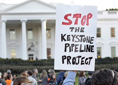 Keystone protest sign in front of White House