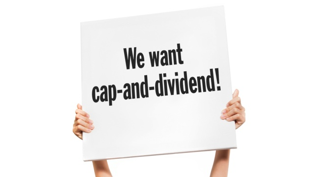 "sign: ""We want cap-and-dividend!"""
