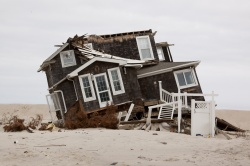 Some waterfront residents would prefer to risk storm surge destruction such as this, in unprotected Mantoloking after Superstorm Sandy, than lose their views.