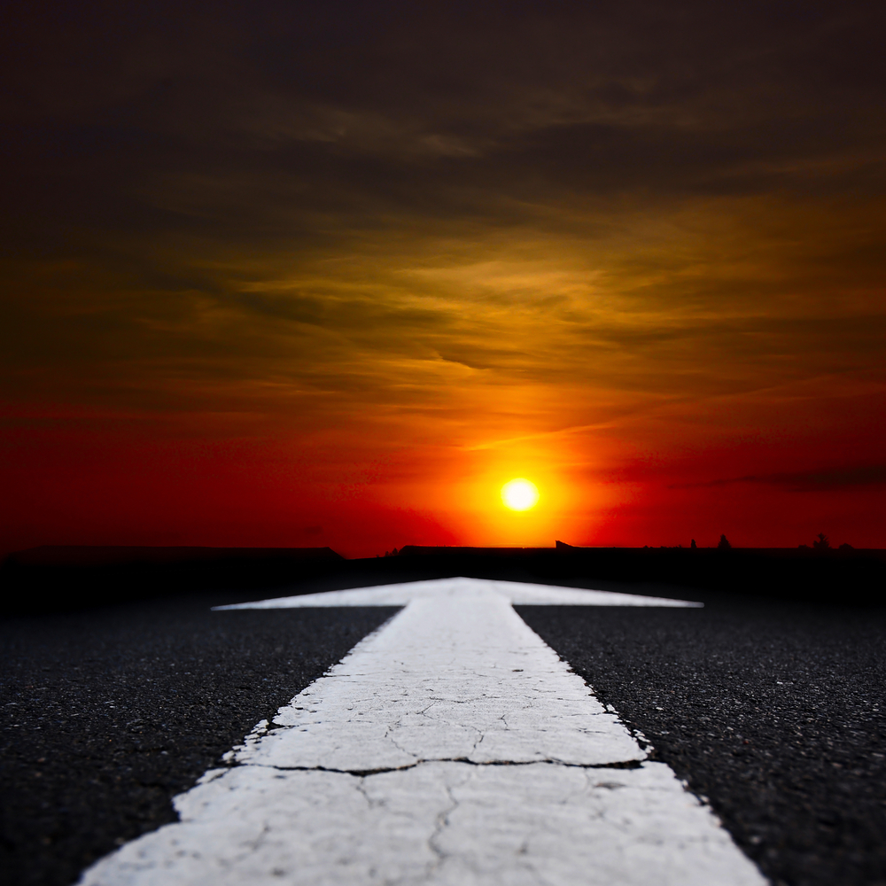 road leading into sunset