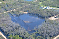 The oil sheen-coated sinkhole, photographed over the weekend by nonprofit On Wings of Care.