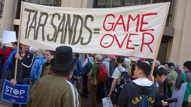 "protest sign: ""Tar sands = game over"""