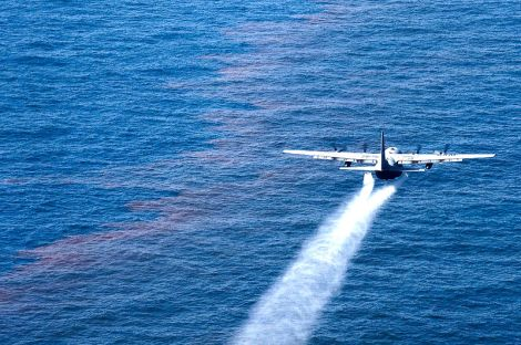 A C-130 Hercules sprays Corexit onto the Gulf of Mexico.