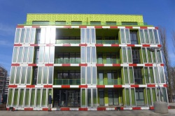 Green paint and panels filled with green algae provide an environmental aesthetic for an environmentally friendly building.