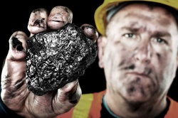 A coal worker holding the actual heart of Peabody Energy chief executive Stephen Howlett