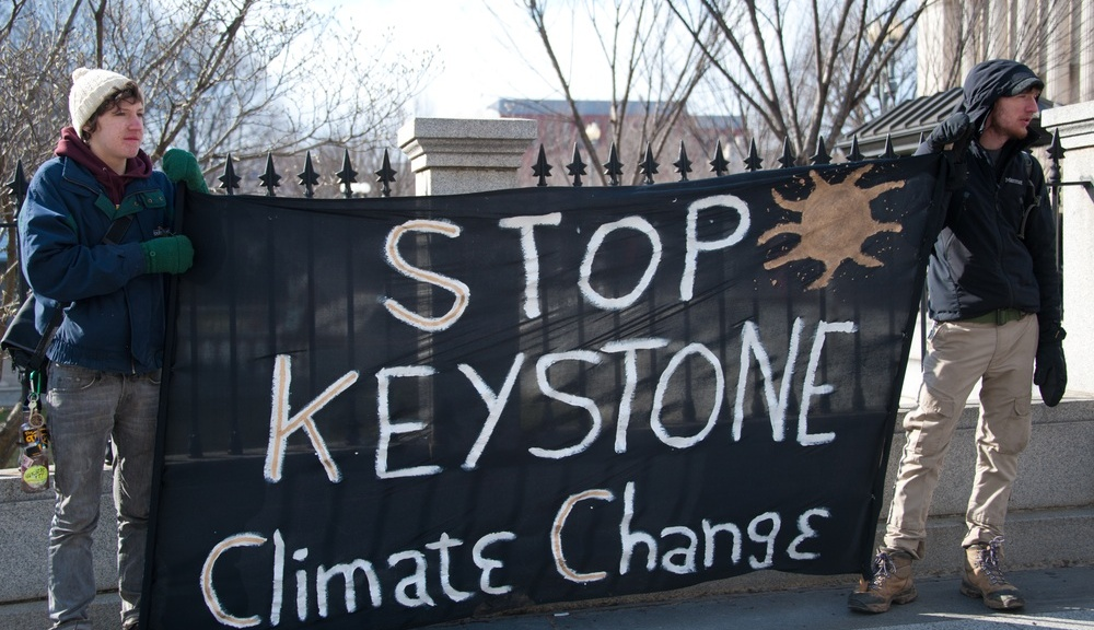 """stop keystone climate change"" sign"