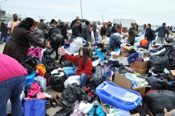 Victims of Hurricane Sandy receive aid in Queens. Expect more scenes like this in the future.