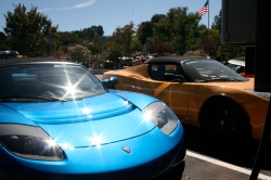 Tesla roadsters charging in the parking lot at the company's Silicon Valley headquarters.