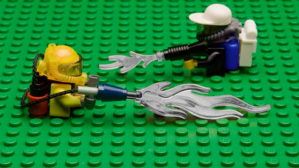 Lego men spraying lego herbicide on a lego field.