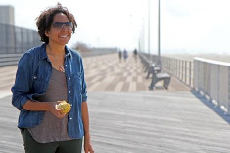 Robyn Hillman-Harrigan on a rebuilt section of the Rockaway Beach boardwalk.