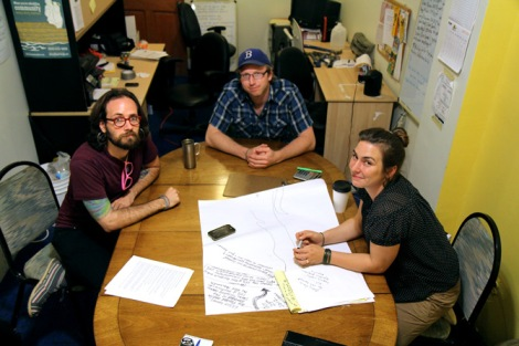 From left: Occupy Sandy organizers Brett Goldberg, Gabriel Van Houten, and Terri Bennett discuss the future of the movement in the back offices of the Pilgrim Church of Arverne.