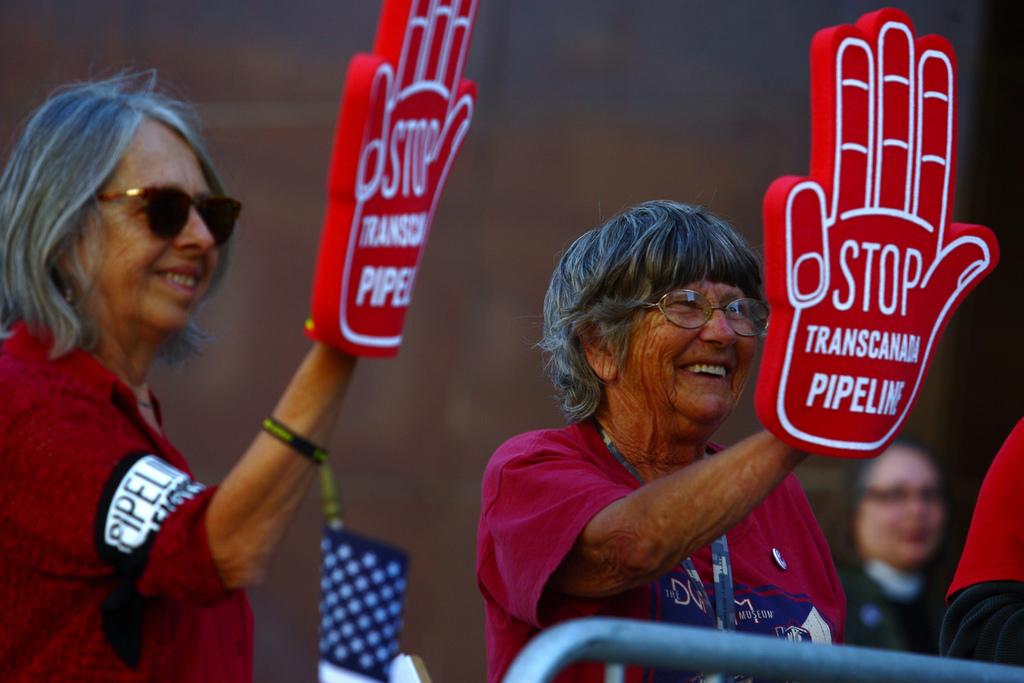 women protesting Keystone
