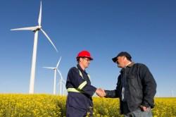 farmer and engineer with wind turbines