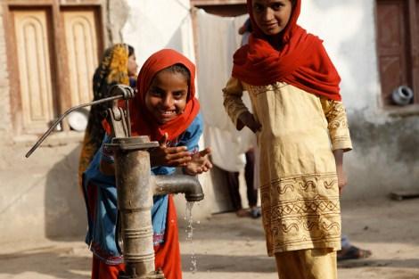 Children in Sindh, Pakistan, play at a water pump in a village near Dadu, in Sindh, Pakistan.