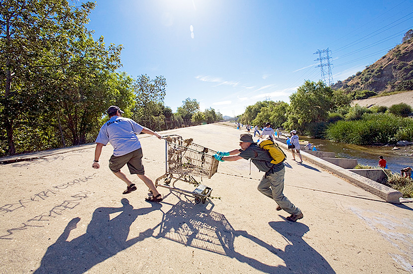 "Volunteers at FoLAR's (Friends of the LA River) annual ""La Gran Limpieza"" clean up of the Los Angeles River, hauling out one of the dozens of shopping carts that end up getting dumped in the river each year."