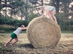 Caitrin and Lake horsing around with hay bales in Nebraska.