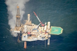Natural gas surrounding a drilling rig Tuesday before it exploded.