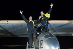 Solar Impulse's pilots, Andre Borschberg and Bertrand Piccard, celebrate after reaching New York.