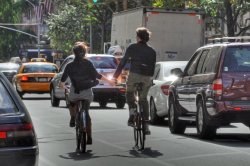 city-bicycling-holding-hands-featured