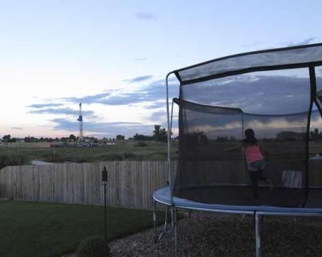 Sunset, trampoline, fracking rig.