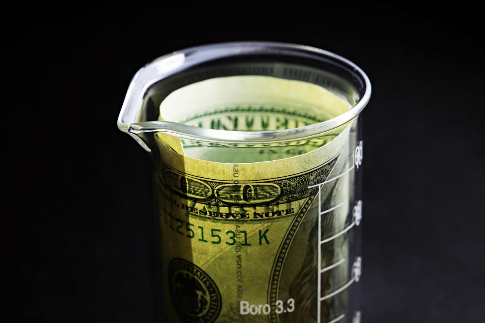 beaker of money