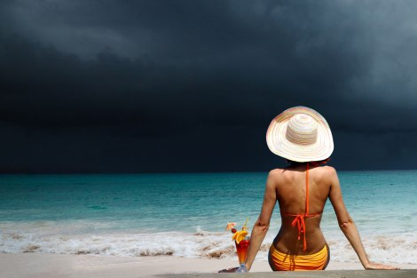 woman-beach-cocktail-ocean-storm-hurricane-small