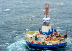 Workers evacuated after Shell's exploratory oil rig ran aground. Turns out it was also in violation of pollution laws.