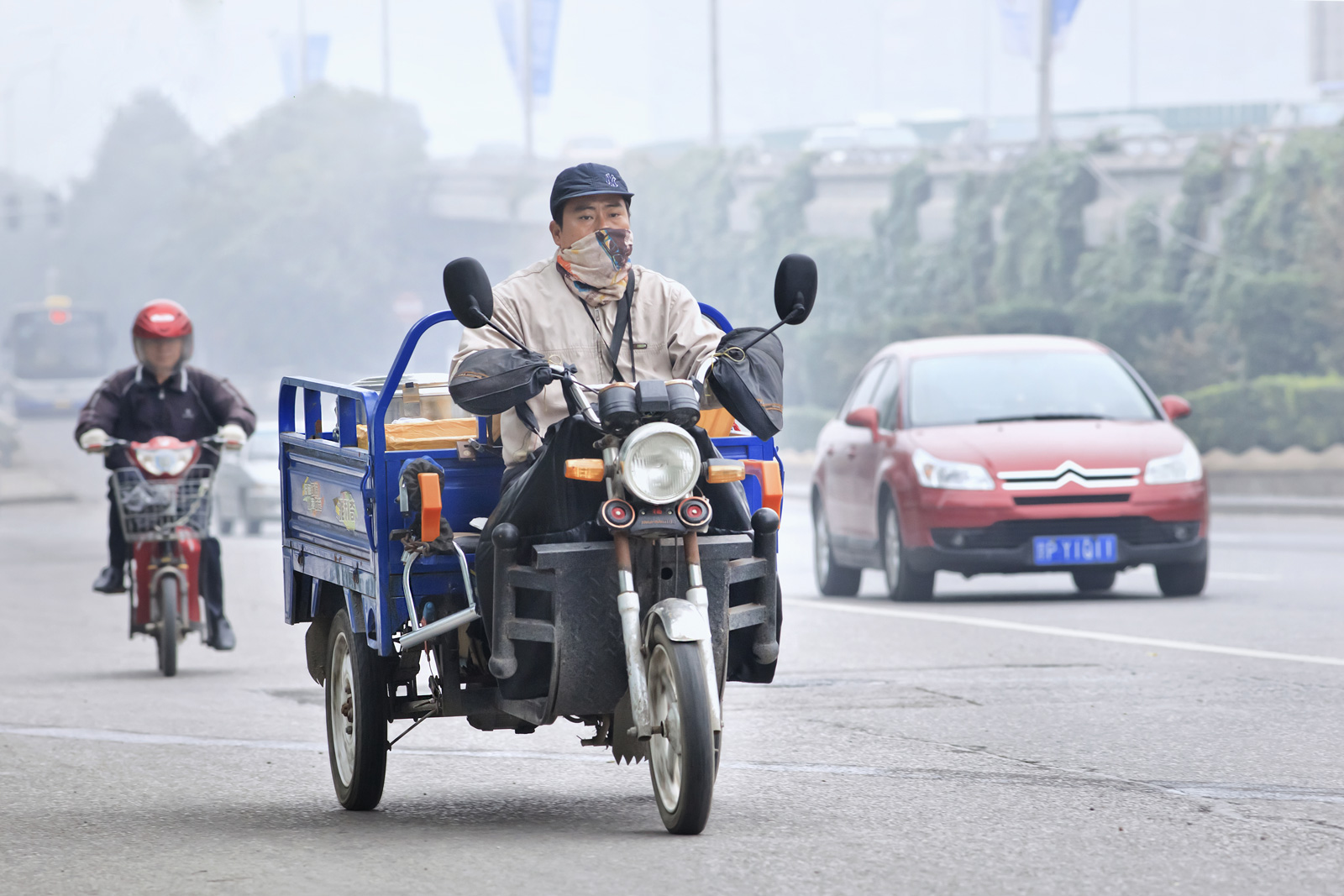 motorcycle driver with mask