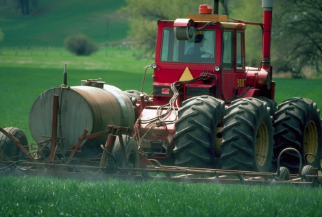 Tractor Spraying Herbicide on Field