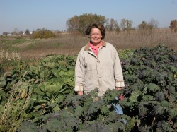 Laura Krause in a field of kale