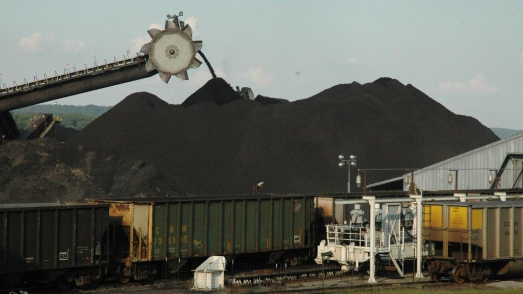 Loading coal onto a ship