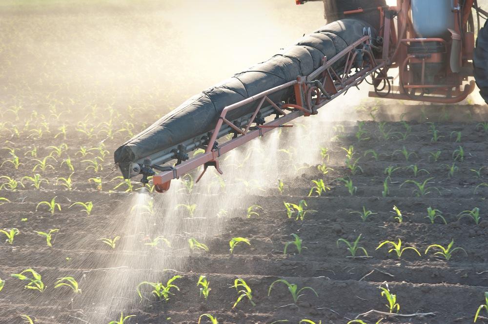 Spraying fertilizer.