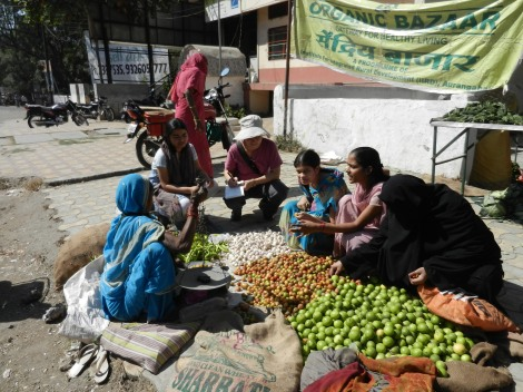 Sarah Elton interviewing women at an organic bazaar in India